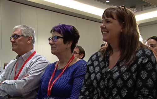 Conference attendees watch keynote speaker Paul Krismer