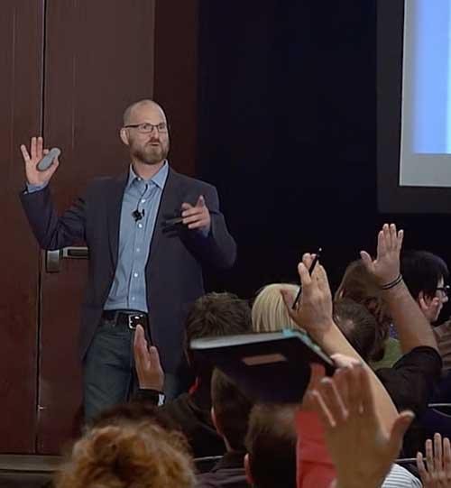 Motivational Speaker Paul Krismer presents to an audience.